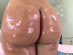 After getting her big butt oiled up, the German pornstar Katja Kassin will take a hardcore vaginal and anal pounding.