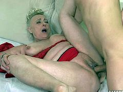 Sila is a sex obsessed granny dressed in red. She opens her legs in front of young guy and gets banged. He licks and fucks her loose many times used pussy like crazy. She takes his rod deep down her throat after vagina.