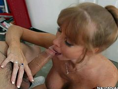 Darla Crane is s gorgeous MILF with huge hooters. David Loso is a bad boy who gets seduced by big racked lady. She removes her bra and he plays with her knockers before she sucks her meaty sausage.