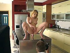 Lily LaBeau is a porn star with great experience. This is backstage with her participation. The girl masturbates her pussy on the glass table. It looks fantastic!