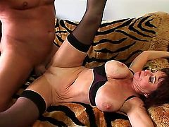 Busty milf spreads her legs and gets a big dick in her tight hole