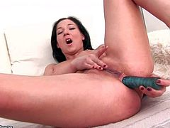 Young arousing brunette babe Anne Angel with natural boobies and slim sexy body gets naughty in bedroom and stuffs her tight ass with blue toy while polishing her hairless pussy to awesome orgasm