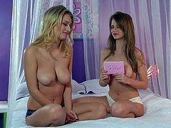 Busty blonde Emily Addison enjoys in giving an interview on the bed with nothing on but her black undies and reveals her big breasts with big pleasure as she talks