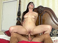 Gorgeous brunette fucked on the bed