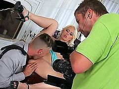 Backstage action with luxury blonde lady Angelina Rich with beautiful boobs, gorgeous features and sexy, slender body fucking with her husbands worker at his work table.