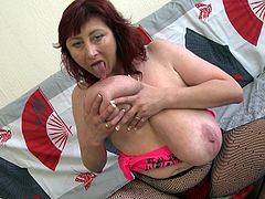 redhead mature plays with her jugs