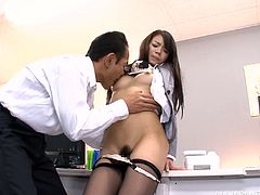 Beautiful and sexy Japanese girl is getting naughty with her boss in an office. She lets him play with her vag and then leans forward and gets her trench pounded from behind.