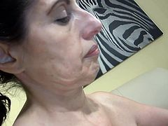 Nanny has something funny in her pussy, it's a carrot shaped sex toy that she takes great pleasure in licking and fucking with it. The years have pasted over our granny but she still look fine and give us an erection. Stay with her and see how she likes to fuck herself like a whore!