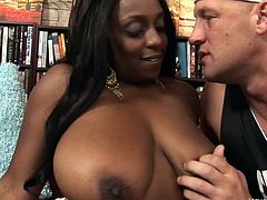 I love seeing ebony whores sucking my hard dick. The feeling of black juicy lips around my dick drives me crazy and this time I got my paws on a black beauty that loves white dicks. I sweet talk her, oil those huge breasts and then fed her my dong. Wouldn't a big load of warm semen look good on her oiled breasts?