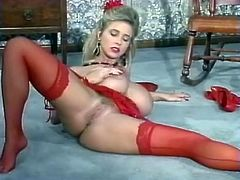 Sexy red lingerie on a fake titties blonde girl