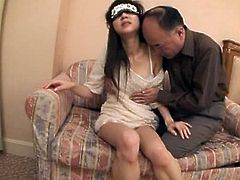 Amazing Japanese girl lies on a sofa getting her vagina licked by an old guy. After that she also takes his dick in wet pussy.