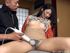 Slutty Japanese chick sits on a chair getting her pussy toyed with a vibrator. After that she sucks a cock standing on her knees.