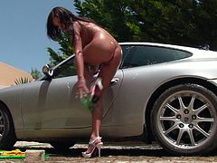 Sexy brunette Henessy is washing a car in the yard. She gets hot and decides to have rest. She squats and begins to rub her clit and pour water on her amazing body.