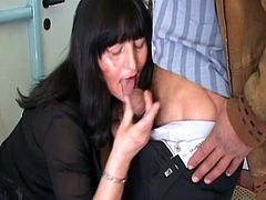 Mature European brunette minding her own business in the cafe eyes a young stud doing poorly on the slot machine and seduces him into going back to her place for hot sex in this free tube video.