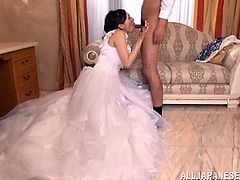 Stunning Japanese girl in a wedding dress drops to her knees and gives passionate blowjob to her future husband.