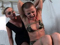 Lustful mistress Kathia Nobili is playing dirty games with kinky bald girl Sinead. She ties her up and then pokes a dildo into Sinead's shaved pussy.