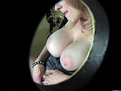 Blonde beauty Vicky Vixen fingers herself while she sucks massive black dong at a gloryhole. Her massive melons flop around after she pulls them out of her top. She sucks the cook deep in this dirty bathrooms stall.