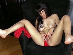 Marie has a pair of long sexy legs and she spreads them wide for us. This brunette hottie enjoys the attention we give her and the thought she's making us horny fills her with lust. Marie keeps her hot thighs spread and fucks her shaved, juicy pussy with that small dildo wishing for a massive dong inside her
