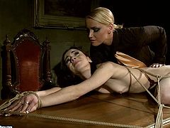 Dark-haired cutie Jeanine Hot is having fun with hot blonde Kathia Nobili in a basement. Kathia ties Jeanine up and gets her snatch destroyed with a dildo.