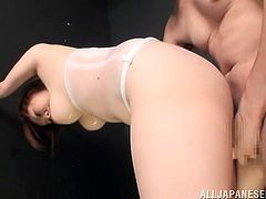 Lovely Japanese chick got some extra fats, which annoys this man. So he puts on some latex thing around her belly and oils her up to fuck her hard.