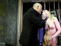 Gorgeous blonde Vanda Lust has fun with some kinky guy in a basement. The man ties Vanda up and then makes her deepthroat his dick and jump on it.
