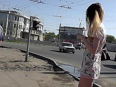 Skinny blonde gets filmed by dirty voyeur while in public scene