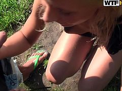 She is whorish blonde girl with sexy fresh body. She unbuttons her dress flashing her tits. Later she kneels down taking a hard rod in her mouth sucking it actively.