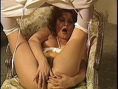 This retro porn video starts off with a guy getting blown by two hot chick. It's even hotter than you think because they are being watched by the dude's old wife while she masturbates her hairy vagina.
