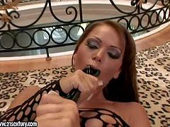 Dirty and big ass brunette hottie Christina Bella really enjoys in exposing her curves as she plays with her favorite sex toy on the floor, wearing only her body stocking