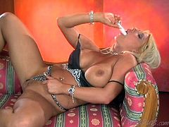 Sexy blonde Candy Manson is playing with her vibrator