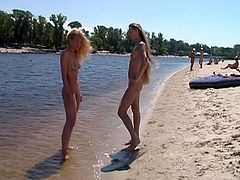 Immature nudist pal undressed together at the sands