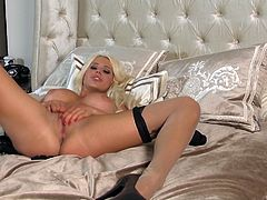 While being alone at home hot slim blondie gonna make a kind of romantic evening for herself. Wearing black sexy stuff appetizing tanned chick with nice boobs moves to the bedroom for fingering her wet pussy and reaching orgasm at once.