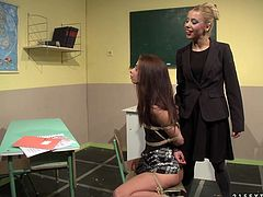 Pretty dark-haired girl Betty Stylle lets her horny teacher Nikky Thorne tie her up and fuck her nice pussy with a realistic dildo.