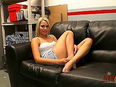 Sitting on the sofa and just looking great. That is what blonde princess Mia Malkova is doing in this video and she is more than great at it.