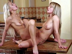 Turned on slender teen blonde Bella Baby with nice natural boobs and long sexy legs gets naked while making out with her tight ass girlfriend and has mind blowing scissoring session with her