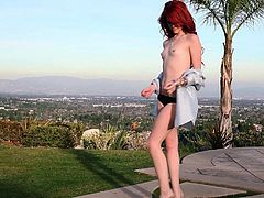 Naughty redhead loves to get nasty in outdoor solo porn session