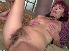 Red-haired mature cowgirl Ria in hat spreads her legs wide in the barn and gets her hairy wet snatch fucked silly by her fuck buddy. He fucks the shit out of bushy flat chested oldie in hardcore action.