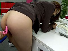 Slutty slim brunette with small tits bends over the table. One of her male colleagues come closer and tickled her wet hairy cunt. Kinky bitch has do nothing but moan madly of satisfaction.