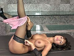 Brown-haired nymph Roxanne Milana plays with her sweet pussy