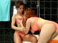 Two curvy red-haired moms in luxurious satin lingerie maul each other steamy bodies before one of them bends down in anticipation for a tongue fuck in steamy lesbians sex video by Fame Digital.