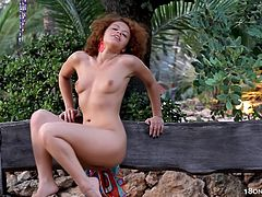Sexy redhead likes posing while masturbating her twat in outdoor solo