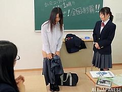 Sweet Japanese girl in school uniform gets punished. She has to take her clothes off and show her perky tits to the whole class.