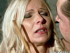 Arousing blonde milf Winnie with huge firm balloons and smoking hot body in white stockings gets tied up and disciplined by filthy long haired dude before he stuffs her face with his cock