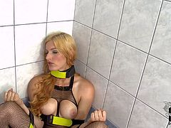 Mira Sunset is one beautiful blonde in crotchless fishnet outfit. Blue-eyed doll with bare tits spreads her legs and and shows her neat pierced pussy before peeing in the bathroom.