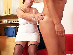 Red-haired mom pokes bearded pussy of submissive hussy with finger