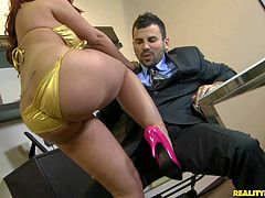 Stunning lusty redhead bombshell Kelly Divine with huge jaw dropping firm ass in golden bikini and pink stripper shoes teases Voodoo and gets on knees to suck hie long meaty cannon