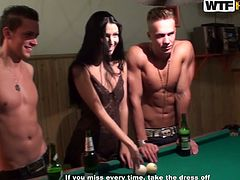 Hot tempered Russian brunette in steamy camisole plays pool surroused by three rapacious dudes. After they drink a significant amount of alcohol, they start taking off her clothes leaving her naked before fucking hard in steamy group sex session by WTF Pass.