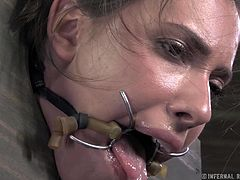Only Casey's ass and face are hanging out of this bizarre box contraption. Her male master doles out nothing but extreme torture and pain in this video. She is fucked in all available holes and fingered grotesquely by her master.
