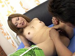 Kinky and hot smiling Japanese brunette with natural tits kisses a dude passionately. Then she lies onto the bed stretching legs wide. Dirty-minded chick needs to get her fluffy pussy tickled tenderly and giggles of pleasure.