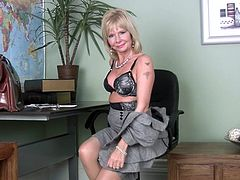 Cathy sometimes gets bored at work. Here she was in her office with nothing to do when suddenly the blonde milf felt horny. She took off her clothes like a bad girl and then while sitting on her chair Cathy spread her legs and started to rub her shaved, pink pussy. Her cunt is juicy and surely she will finger it